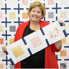 Jenny demonstrates how to make a quick and easy Linked Up quilt using yardage and just one pack of 5 inch squares of precut fabric (charm pack). She used Coney Island Charm Pack by Fig Tree & Co. (Joa