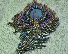 Beaded Peacock Feather Brooch with Agate. $175.00, via Etsy.