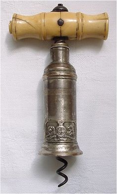 Thomason type corkscrew, with turned bone handle, applied badge with lion and unicorn