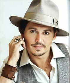 Johnny Depp what a cute look on his face!