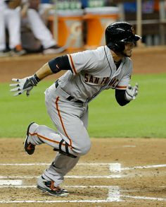 San Francisco Giants' Gregor Blanco heads to first base after hitting an infield single against the Miami Marlins in the fifth inning of a baseball game in Miami, Friday, July 18, 2014. (AP Photo/Alan Diaz)