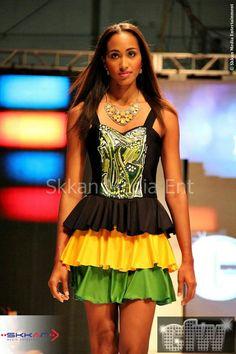 Bayroc yellow black and green dress at Caribbean fashion week in Jamaica