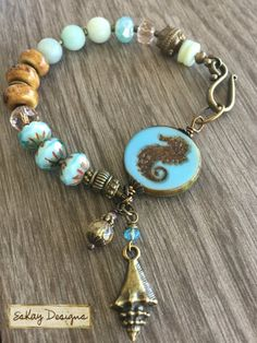 Turquoise Seahorse Beaded Bracelet by EsKayDesignsSK on Etsy