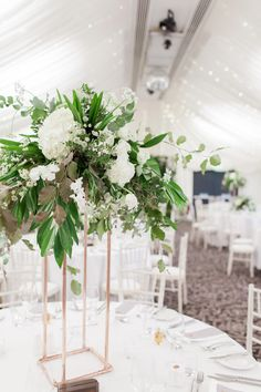 Tall Floral Centrepiece on Copper Plinth | Greenery & White Marquee Wedding at The Villa, Levens with Copper Details | Bowtie and Belle Photography