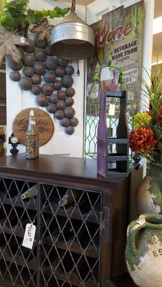 Such a great solid wine cabinet, and check out the galvanized pendant light!