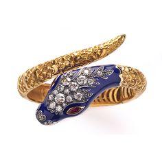 Vendôme.- Pulsera con forma de serpiente. siglo XIX. En oro, esmalte azul, diamantes y rubíes