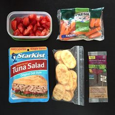 Fresh strawberry slices, baby carrots, tuna salad, clubhouse crackers, and a raspberry Stretch Island Fruit Co. strip.