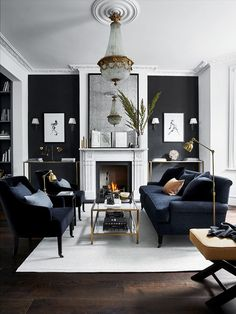 Accenting black against white is a great way of highlighting architectural details. Here the recesses are transformed into monochrome masterpieces, where perfect symmetry keeps the room's feng shui en pointe. Add elegance and femininity with a statement chandelier for a room fit for entertaining. #livingroom #darkinteriors #blackpaint #realhomes