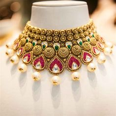 A stunning choker for a regal bridal look - we love the use of coloured stones and pearls in this unique heirloom necklace - Indian wedding - Indian bride - Indian wedding jewels - Indian jewellery - wedding jewellery - pearl and gold jewellery #thecrimsonbride
