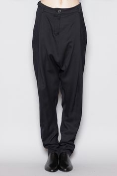 Totokaelo - Damir Doma, Pelaga trousers. Drop crotch trousers in a woven fabric. Long leg with front panel pleating. Front slit and single rear button pouch pocket. Zip fly button closure with belt loops and adjustable side straps.