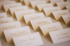 ivory and gold escort cards, gold calligraphy // Events by Satra // Mischa Photography
