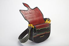 Carriel --a small leather satchel similar in appearance to a saddlebag, but worn over the shoulder . Carrieles are either made of rawhide or nutria fur, typical of the Antioquia region of Colombia. This bag is synonymous with paisa culture and commerce and is a beloved symbol of the industriousness and honesty of antioqueños. $150.00