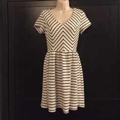 """Striped a line dress Very cute striped a line dress with a v neckline. Chevron stripes on the bodice make for a very trendy style for work, casual, or special occasions. Wear in the winter with tights and booties! I am 5'4"""" and it sits a few inches above the knee. It is a off white color--not quite cream though. Francesca's Collections Dresses Mini"""