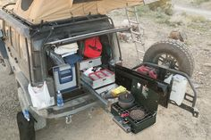 Check out this overlanding kitchen system that fits in the back of a Jeep, FJ, Land Rover and other vehicles as well. Good use of space, great for adventure!