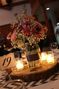 The reception centerpieces featured white roses and babys breath in mason jar centerpiece with candles i do like the candles surrounding use the fake candles obvs junglespirit Image collections