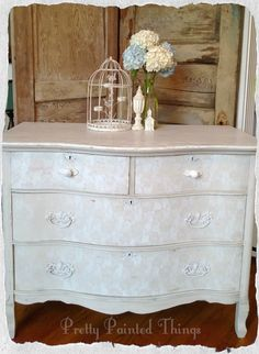 Old bow-front dresser gets a make over with a subtle lace paint effect on front.