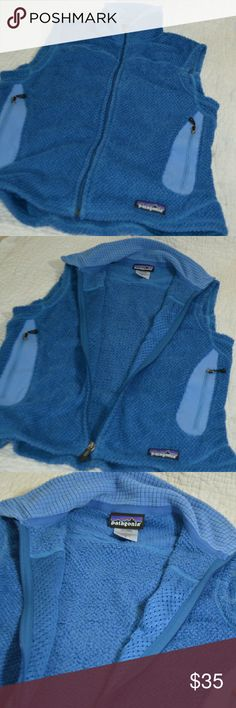 "PATAGONIA Women's Blue Fleece Vest Size S (12-02) PATAGONIA Women's Fleece Vest Polartec Blue Lightweight Full Zip Size S     This vest has two zippered handwarmer pockets. It's a full-zip vest with a stand-up collar. It has Princess seams on front and back for a feminine contour  100% polyester  Length 22.5""  COLORS ARE DESCRIBED TO THE BEST OF MY KNOWLEDGE. THE COLOR SUGGESTIONS ARE NOT THE MAKERS SUGGESTION UNLESS STATED ON THE TAG. I TRY TO DO MY BEST OT DISPLAY THE BEST COLOR POSSIBLE…"