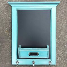 Entry organizer - chalkboard / mail cubby / coat and key rack all in one!   Made from a cabinet door, scrap plywood & a couple odd pieces of trim.  Supplies from & made by Cabinet Doors & More in Fordsville, KY.