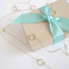 """I made this necklace as a custom order for a wonderful customer, and loved it so much I had to share!I've suspended six equally spaced small gold filled circles from gold filled chain. This can also just be worn without doubling for a long necklace. The total length is 46"""".♥ Diamter of circles: 3/8"""" (10mm)♥ Total length of necklace: 46""""♥ All components gold filled/sterling silver"""