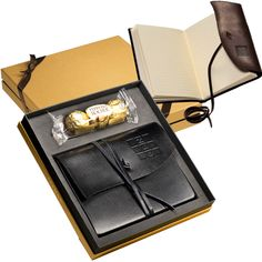 Ferrero Rocher® Chocolates & Wrapped Journal Gift Set Leeman New York Ferrero Rocher® Chocolates & Wrapped Journal Gift Set. Includes the Americana Leather-Wrapped Journal and a 3-pack of Ferrero Rocher® Hazelnut Chocolates. Full-grain, leather-wrapped journal book includes lined journal pages and leather wrap/tie closure. Available late September. New item! Lifetime Guarantee. Supplier is QCA certified.