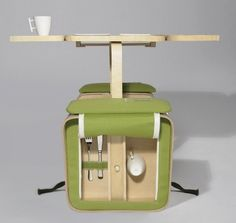 Bicycle Rack Picnic Basket unfolds into chairs and a table. Yep.