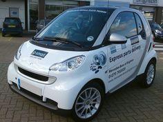 Mercedes Brighton Part's Smart car with printed vinyl graphics.