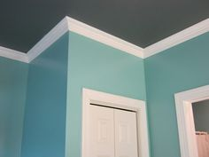 Liking the charcoal gray and Tiffany blue together. This was also an amazing bathroom makeover!