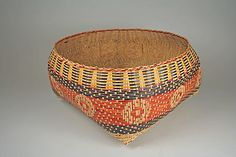 Basket  Attributed to Ernestine Walls  Date: 1970s or later Geography: United States, Louisiana Culture: Chitimacha Medium: Dyed rivercane Dimensions: H. 8 x W. 13 1/2 in. (20.3 x 34.3 cm)