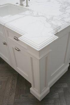 nice corner detail on marble kitchen island