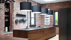 Brick walls mixed with industrial appliances and fixtures giving any kitchen contemporary, distinguished design