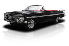 The 1959 Impala is one of the most sought after cars of Detroit's golden era, and examples like this professionally restored convertible are great reminders why. Want to get your name engraved on a few trophies? Get to know this awesome Chevy drop-top! The beneficiary of a frame-off restoration, which refurbished a roster of original trim parts, this classic Impala is a top-notch cruiser that makes no excuses. Lift the car's long hood and you'll find a 348 cubic inch Turbo Thrust V8 that's…