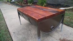 These are storage tables that I make from 55 gallon drums and reclaimed 2x6's. Top is on hinges to open up.