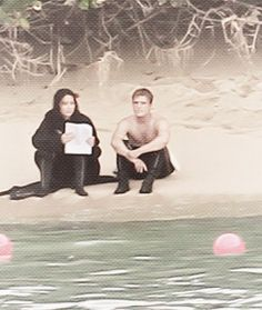 Jen and a shirtless Josh filming 'Catching Fire'