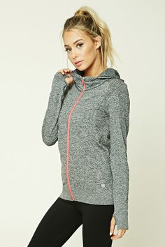 A seamless heathered knit athletic hooded jacket featuring a contrast zip-up front, ribbed trim, and long sleeves with thumb inserts.