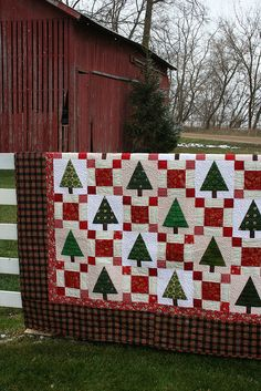 Christmas quilt.  Try doing with paper...each kid does a tree block and a squares block