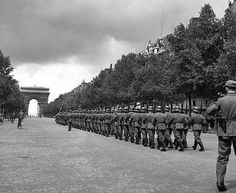 Parade of German occupation troops along the Champs Elysees, Paris, June 1944. Photo © Serge de Sazo