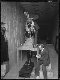 Arthur Mace and Alfred Lucas work on conserving a life-size statue of Tutankhamun that guarded the entrance to the king's burial chamber, Photo by Harry Burton, 1922 Monuments, The Boy King, King Tut Tomb, Life Size Statues, Night At The Museum, Archaeological Discoveries, Valley Of The Kings, Egyptian Art, African History