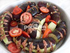 Hem sebzeli hem de etli bir yemek olan patlıcan kebabı tarifinin pratik yapılışını öğrenebilirsiniz.