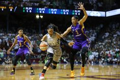 Minnesota Lynx forward Maya Moore (23) drives the ball around Los Angeles Sparks center Candace Parker (3) in the first half of Game 1 in the WNBA basketball final, Sunday, Sept. 24, 2017, in Minneapolis. (Stacy Bengs/Associated Press)