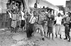 "A Northumberland Fusilier imposes law and order on Arab demonstrators during a disturbance in Aden, Far from phlegmatically British, British suppression of ""ters"" and others objecting to British rule was often brutal and deadly. British Soldier, British Army, South Yemen, Dad Pictures, Crown Colony, Arab Spring, Hands In The Air, Law And Order, Vietnam War"