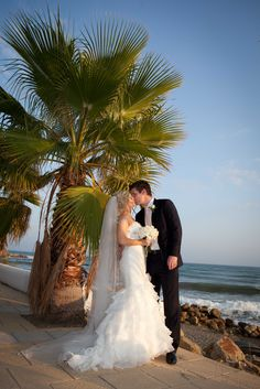 Bride and groom on the beach in Spain after getting married abroad