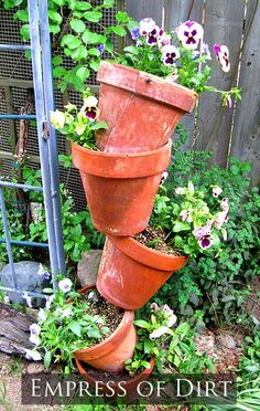 how to make tipsy pots - see the simple trick behind these wonderful planters