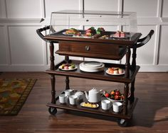 This elegant Tea and Dessert island on wheels is perfect for a leisurely and elegant high tea. Knock on Wood  #KNW #furniture #wood #teaanddessert #trolley #interiors #designers #inspiration