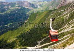 cableway that goes the mountain in summer - stock photo