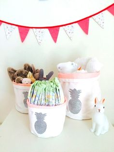 """Storage Bins """"Pineapple"""". With their delicate patterns and lovely illustrations, these poetic handmade cotton bins are perfect to decorate any room or bathroom and store anything you'd like (toiletries, clothes, toys...). Very convenient to use, they are foldable to adjust their height. Available in 3 sizes. From $20"""