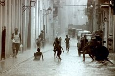 Children playing in the rain on the streets of Havana, Cuba. Arturo Gutierrez @Smithsonian Magazine