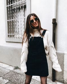 white sweater, black skirt overalls, black fishnet tights, black sunglasses