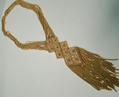 Gold tone fringe necklace, by Monet. c. 1970s. Sold for $ 112