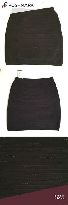 "SUBMIT OFFER  Black Mini Skirt Brand new with tag. Size small. Stretchy fit. Small beading on front. Length approx 14.5"". Elastic waistband. Polyester/spandex blend. iConcepta Boutique Skirts Mini"