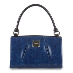 """*Miche Canada* Its sapphire jewel tone gives the Adrian Shell for Classic Bags a totally unique look along with a healthy dose of """"wow""""! Just imagine how this striking Shell will complement your favourite white slacks or little black dress. Abstract honeycomb textured faux leather design, classic center pleated folds and logo plate complete the look."""